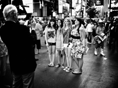 Photo of tourists taking each other's photo in Times Square, New York