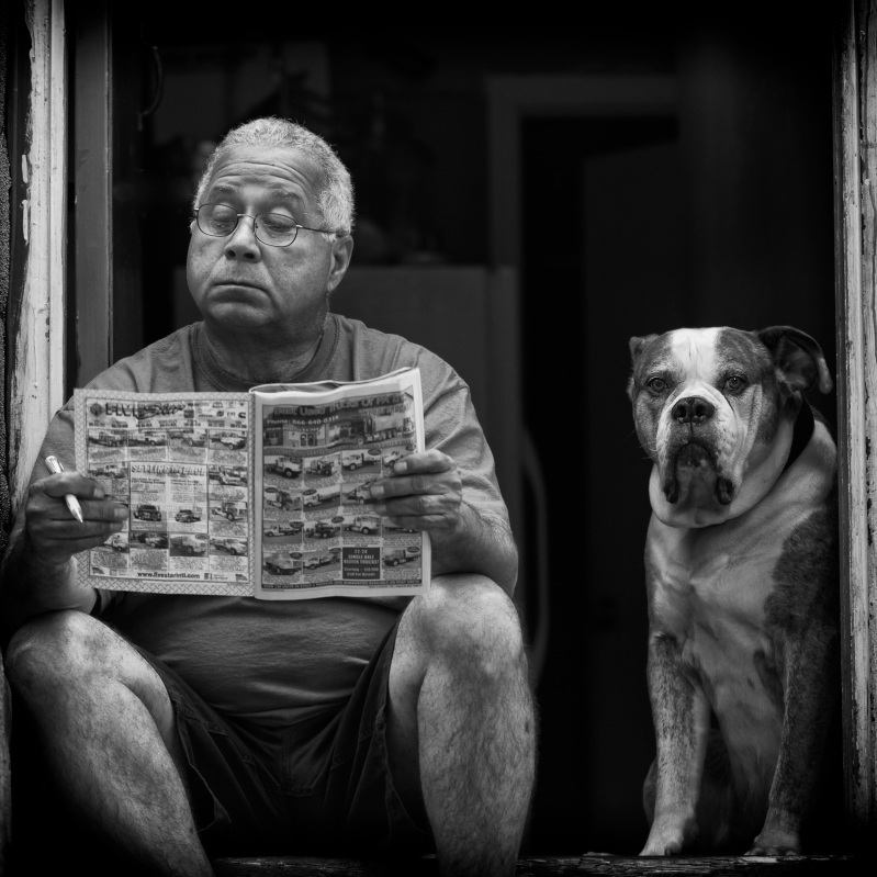 Man and Dog sitting on Doorstep