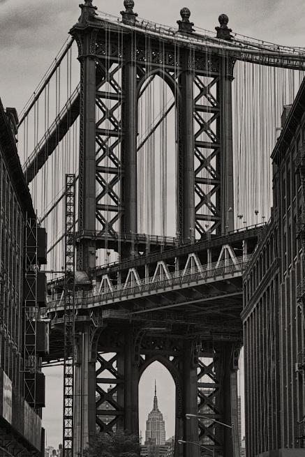 Empire State Building seen through the Williamsburg Bridge