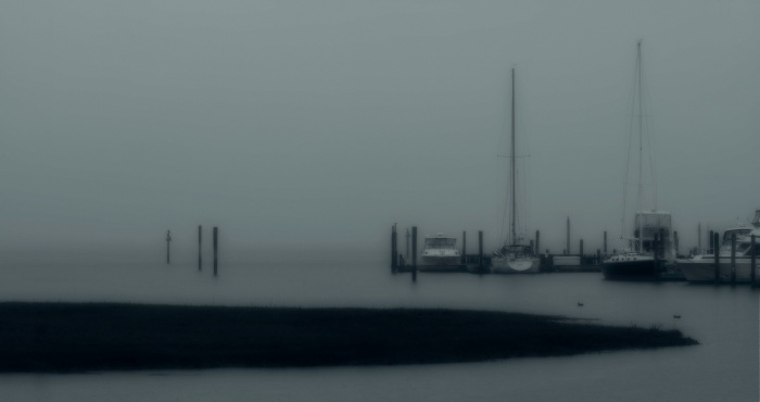 Boats in misty morning weather