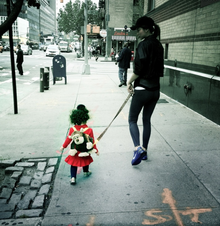 Small child on a leash