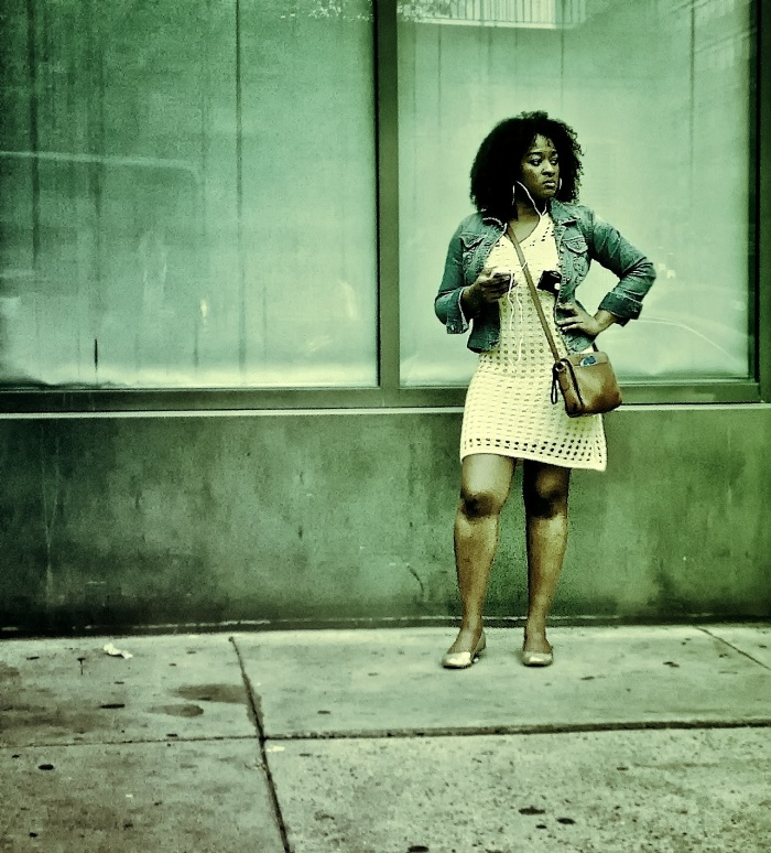 Black woman waiting for the bus
