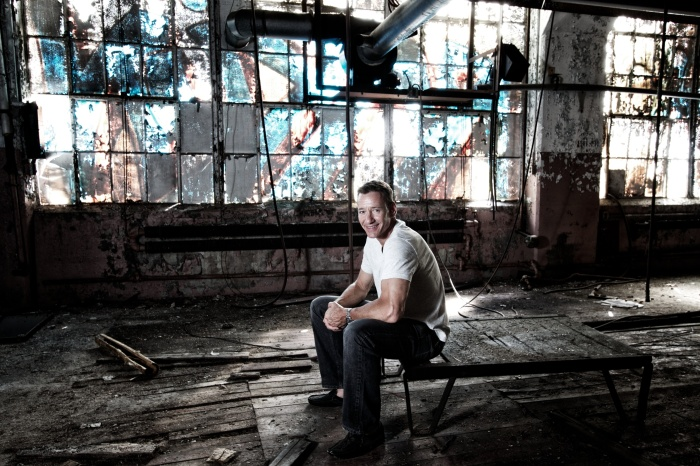 Man sitting in abandoned factory