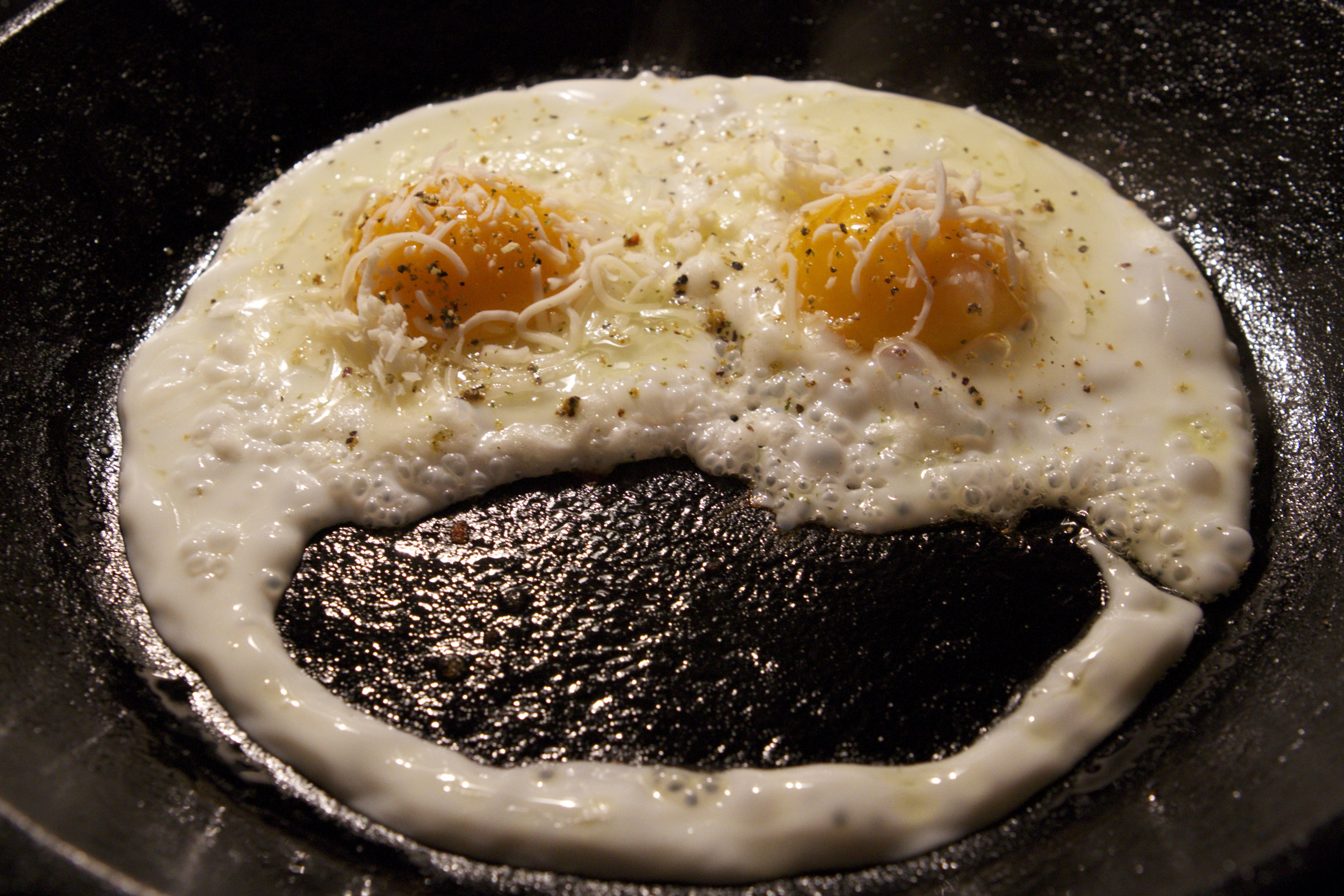 Smiley face made of frying eggs