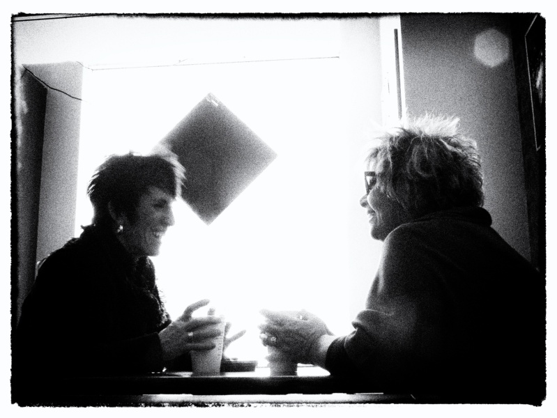 2 ladies chatting over coffee