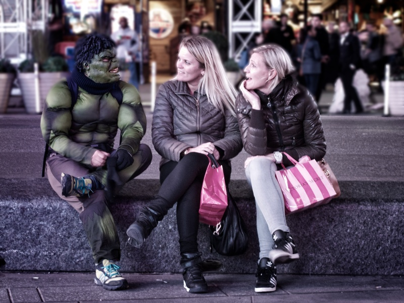 tourists chatting with a Hulk character