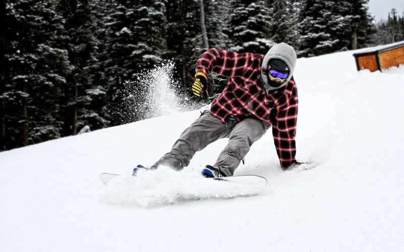Snowboarder landing