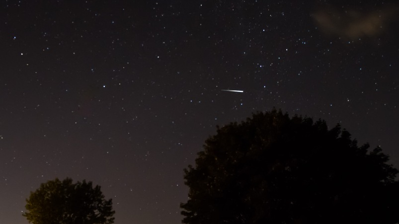 Meteor in night sky