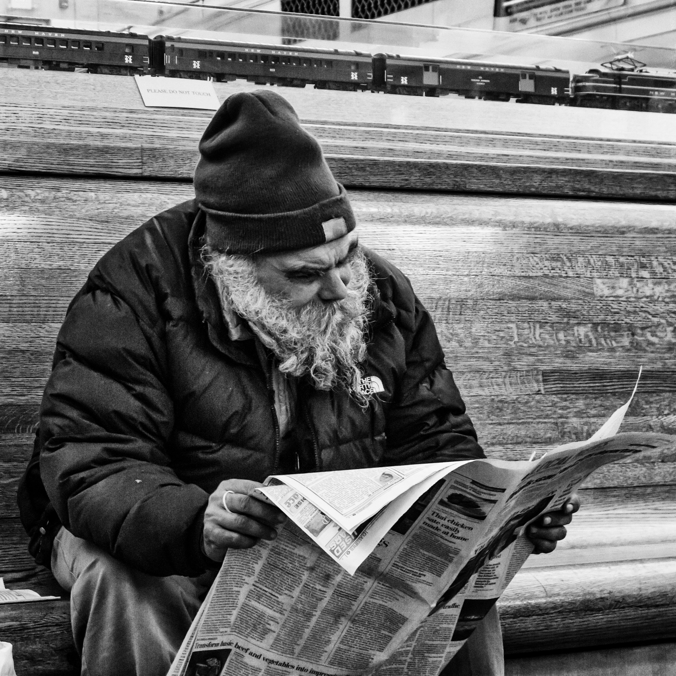 old man reading a paper