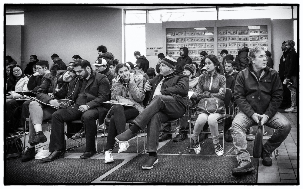 bored people waiting at the DMV office