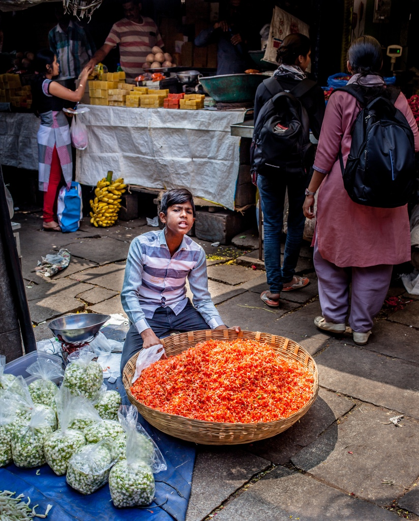 boy selling flowers in India